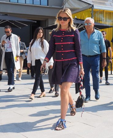 MILAN, ITALY -JUNE 16, 2018: Fashionable woman walking in the streets after Neil Barrett fashion show, during Milan Fashion Week Men and women spring collections.