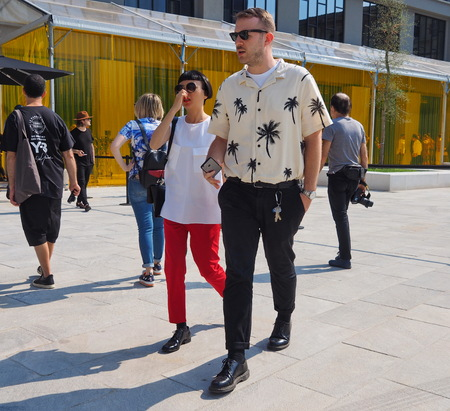 MILAN, ITALY -JUNE 16, 2018: Eccentric man walking in the street after NEIL BARRETT fashion show, during Milan Fashion Week Men and women spring collections. collections.
