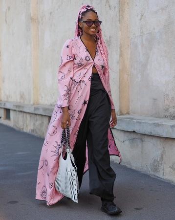 MILAN, Italy: September 20 2018: Fashionable woman in the street before PRADA fashion show during Milan Fashion week Fall winter 20182019.