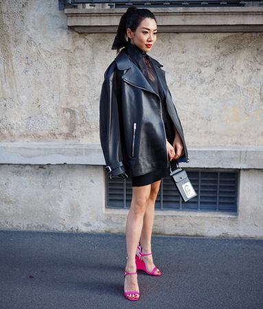 Milan, Italy: 20 September 2018. Fashion blogger in the street before the PRADA FASHION SHOW