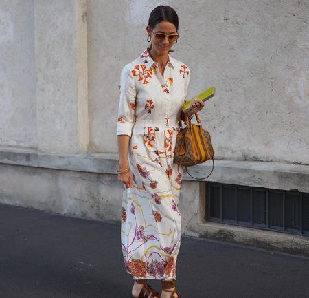 Milan, Italy: 20 September 2018. Fashionable woman walking in the street before the PRADA fashion show, during Milan fashion week fall winter 20182019 Editorial