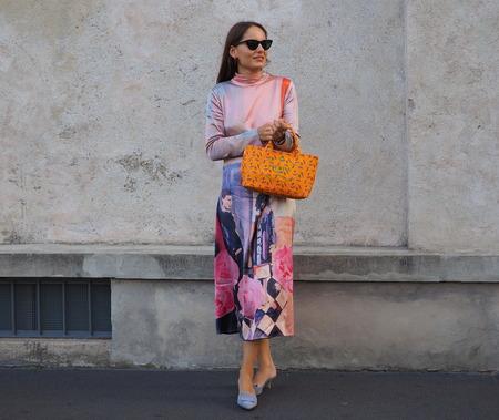 Milan, Italy: 20 September 2018. Fashionable woman posing in the street before PRADA fashion show, during Milan fashion week fall winter 20182019