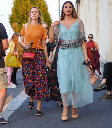 Milan, Italy, 20 september 2018: Fashionable women walking in the street before the PRADA fashion show, during Milan fashion week fall winter 20182019 Editorial