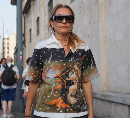 Milan, Italy, 20 september 2018: Fashionable woman walking in the street before the PRADA fashion show, during Milan fashion week fall winter 20182019