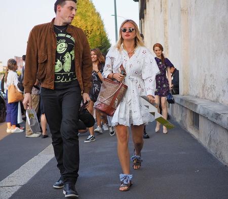 Milan, Italy, 20 september 2018: Fashionable couple walking in the street before the PRADA fashion show, during Milan fashion week fall winter 20182019