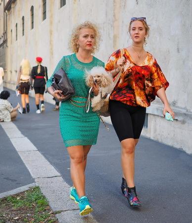 Milan, Italy, 20 september 2018: Fashionable women walking in the street before the PRADA fashion show, during Milan fashion week fall winter 2018/2019