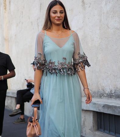 Milan, Italy, 20 september 2018: Woman posing the street before PRADA fashion show, during Milan fashion week fall winter 20182019