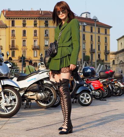 Milan, Italy: September 19 2018: Asian woman posing for photographers before ALBERTA FERRETTI fashion shows