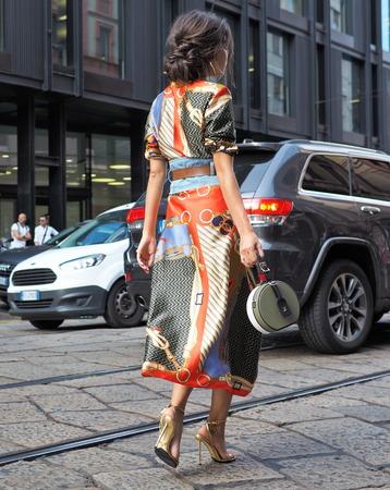 MILAN, Italy: September 19, 2018: Woman street style outfit before ANNAKIKI fashion show during Milan fashion week fall / winter 2018/2019.