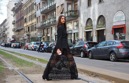 MILAN, Italy: February 24, 2019: Top model Sara Rossetto street style outfit after Dolce & Gabbana fashion show during Milan fashion week Fall / winter 2019/2020 Editoriali
