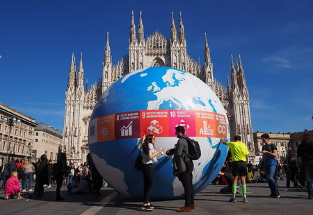 MILAN, Italy: 15 March 2019: Fridays for future, student strikes in the Duomo square with a big globe for climate actions.