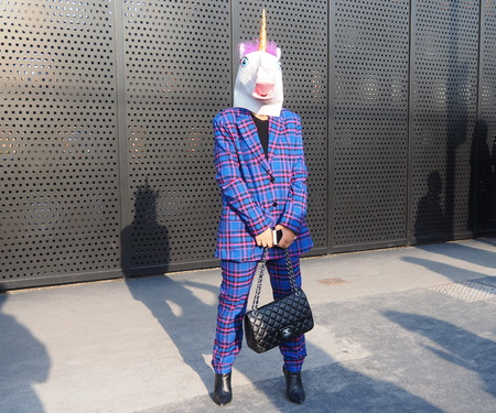 MILAN, Italy: February 20, 2019: Fashion bloggers posing with unicorn mask before Gucci fashion show during Milan fashion week Fall  winter 20192020