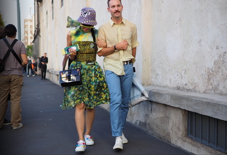MILAN, Italy- SEPTEMBER 20, 2018: Fashionable couple street style outfit before PRADA fashion show, during Milan Fashion Week fall winter 20182019. Editorial
