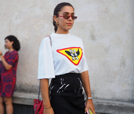 MILAN, Italy- SEPTEMBER 20, 2018: Fashionable woman street style outfit before PRADA fashion show, during Milan Fashion Week fall winter 20182019.