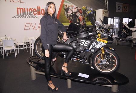 Verona, Italy - January 19, 2019: Verona motor bike expo, model posing on motorbike.