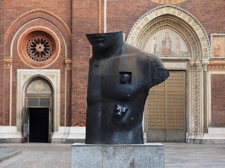 Milan, Italy: 16 April 2019: Outdoor sculpture Chest in Half by Igor Mitoraj in front of church Church of Santa Maria del Carmine in the Brera district of Milan city -