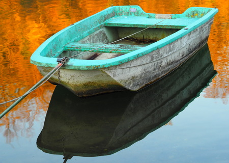 A blue boat on Adda river, Lombardy, Italy.