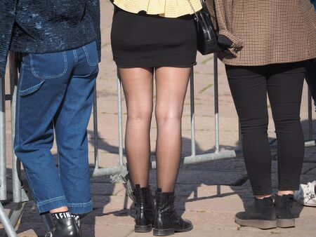 Miniskirt and legs in black pantyhose