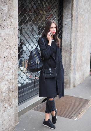 MILAN, Italy: 24 February 2019: Model street style outfit after Dolce & Gabbana fashion show during Milan fashion week Fall / winter 2019/2020