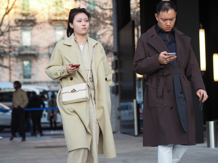 MILAN, Italy: 12 January 2019: Fashion in street style outfits before Neil Barrett fashion show during Milan fashion week Man fall / winter 2019/2020.