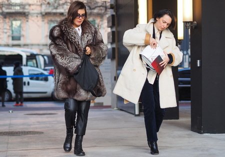 MILAN, Italy: 12 January 2019: Fashion bloggers street style outfits before Neil Barrett fashion show during Milan fashion week Man fall / winter 2019/2020.