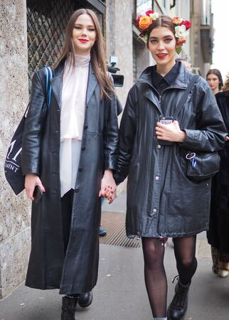 MILAN, Italy: 24 February 2019: Beauty models street style outfit after Dolce & Gabbana fashion show during Milan fashion week Fall / winter 2019/2020 Editorial