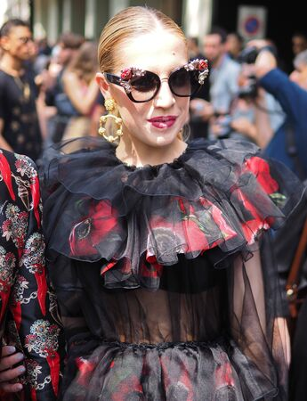 MILANO, Italy: June 15, 2019: Fashion blogger street style outfit before Dolce & Gabbana fashion show during Milan Fashion Week man 2019/2020