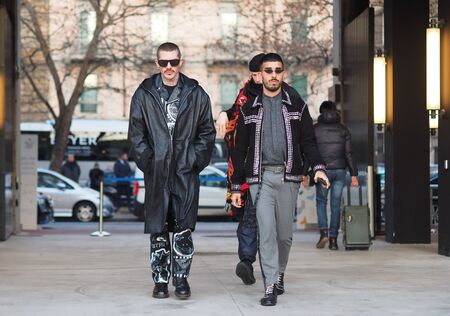 MILAN, Italy: 12 January 2019: Fashion bloggers in street style outfits before Neil Barrett fashion show during Milan fashion week Man fall / winter 2019/2020. Sajtókép
