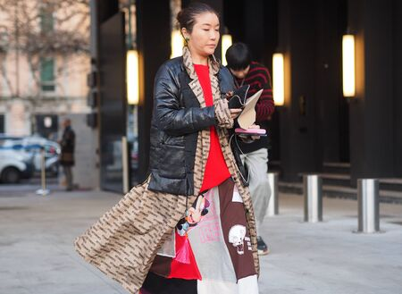 MILAN, Italy: 12 January 2019: Fashionable woman in street style outfit before Neil Barrett fashion show during Milan fashion week Man fall / winter 2019/2020. Sajtókép