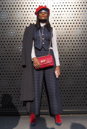 MILAN, Italy: February 20, 2019: Gisele de Assis street style outfit before Gucci fashion show during Milan fashion week Fall  winter 20192020