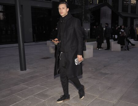 MILAN, Italy: 12 January 2019: Fashion bloggers street style outfits after Neil Barrett fashion show during Milan Fashion Week man Fall / winter 2019/2020