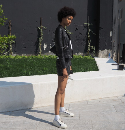MILAN, ITALY - JUNE 16, 2018: Model posing in the street after Neil Barrett fashion show, during Milan Fashion Week Men and women spring collections.