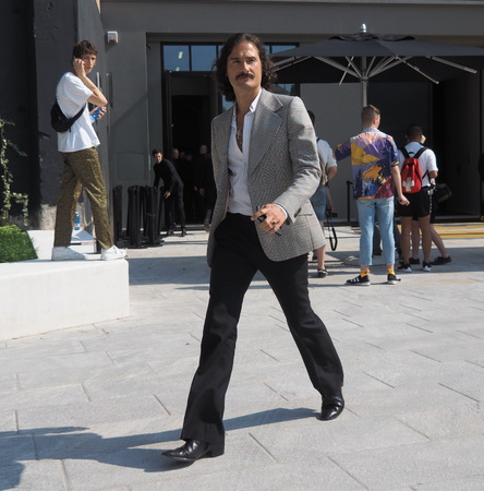 MILAN, ITALY -JUNE 16, 2018: Fashionable man walking in the street after Neil Barrett fashion show, during Milan Fashion Week Men and women spring collections.