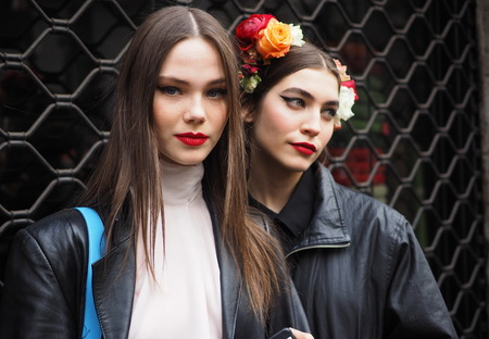 MILAN, Italy: 24 February 2019: Models style street outfits after Dolce & Gabbana fashion show during Milan fashion week Fall / winter 2019/2020