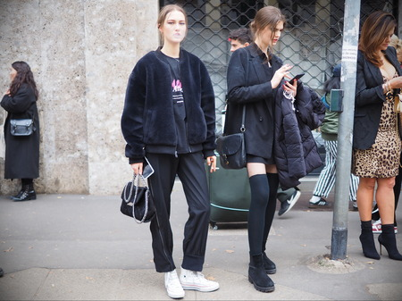 MILAN, Italy: 24 February 2019: Two models in the street after Dolce & Gabbana fashion show during Milan fashion week Fall  winter 20192020 Editorial