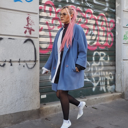 MILAN, Italy: February 20, 2019: Fashion blogger street style outfit before Byblos fashion show during Milan fashion week Fall  winter 20192020.