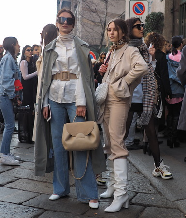 MILAN, Italy: February 20, 2019: Fashion bloggers street style outfits before Byblos fashion show during Milan fashion week Fall  winter 20192020.