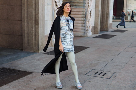 MILAN, Italy: February 20, 2019: Fashion blogger street style outfit before Alberto Zambelli fashion show during Milan fashion week Fall  winter 20192020