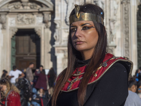 MILAN, Italy: March 9, 2019: Model posing in the Duomo square during carnival parade for photographers