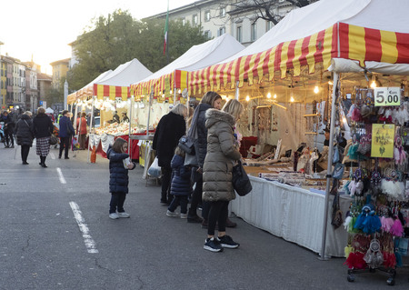 Traditional Christmas Market with Local Stakeholders Selling Seasonal Gifts, Xmas Decorative Ornaments, Chestnut, Handicrafts, Ancient Classic Italian Christmas Treats