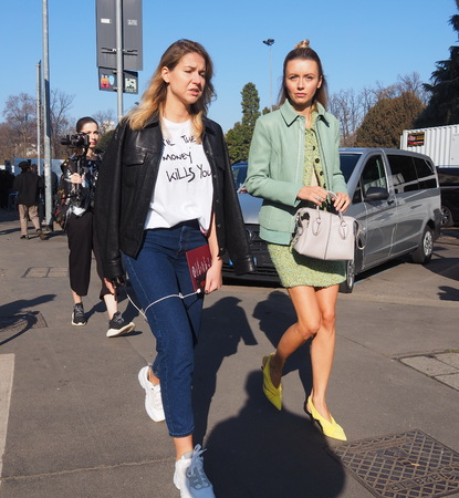 MILAN, Italy: February 22, 2019: Models style street outfits after TODS fashion show during Milan fashion week Fall  winter 20192020 Editorial