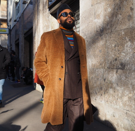 MILAN, Italy: 12 January 2019: Street style outfit before DOLCE & GABBANA fashion show during Milan Fashion Week man Fall  winter 20192020