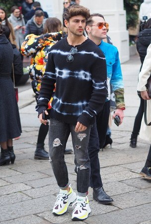 MILANO, Italy: 12 January 2019: Fashion blogger street style outfit before M1992 fashion show during Milan fashion week Man fall  winter 20192020.