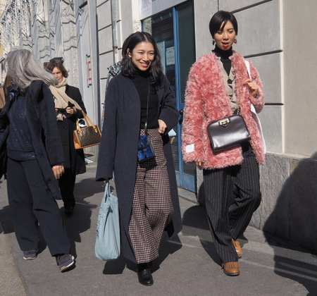 MILAN, Italy: February 21, 2019: Fashion bloggers street style outfits before Armani fashion show during Milan fashion week Fall  winter 20192020