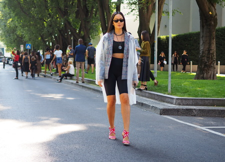MILAN, Italy: 23 September 2018: Woman in street style outfit before Armani Fashion show 2018 during Milan Fashion week fall winter 20182019.