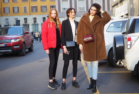 MILAN, Italy: 13 January 2019: Models street style outfit after DAKS fashion show during Milan Fashion Week man Fall  winter 20192020