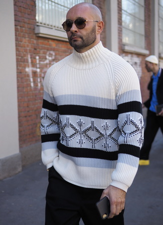 MILAN, Italy: 14 January 2019: Fashion blogger street style outfit before FENDI fashion show during Milan Fashion Week man Fall  winter 20192020