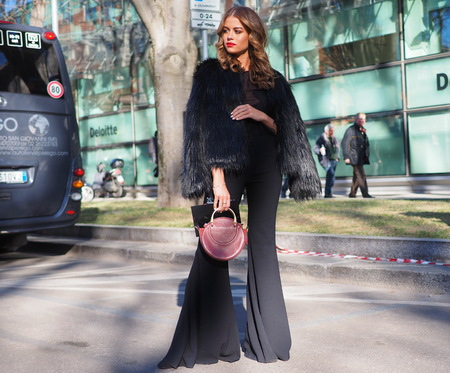 MILAN, Italy: 14 January 2019: Fashion blogger street style outfit before ARMANI fashion show during Milan Fashion Week man Fall  winter 20192020