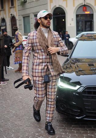 MILAN, Italy: 13 January 2019: Fashion blogger street style outfit before DAKS fashion show, during Milan fashion week Man fall  winter 20192020
