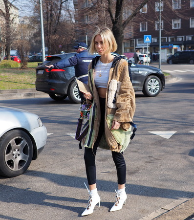 MILAN, Italy: February 21, 2019: Lisa Hahnbuck street style outfit before Fendi fashion show during Milan fashion week Fall  winter 20192020